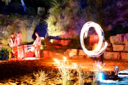 Fire twirlers and Drummers perform for the Dream Time in the Bush area